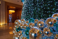 Christmas tree with blue decorations. Beautiful and big Christmas tree with blue decorations Royalty Free Stock Photography