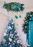 Christmas tree with blue and silver details in the interior Royalty Free Stock Photography