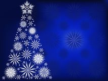 Christmas tree in the blue snow flakes Stock Photo