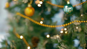 Christmas tree in blur with garlands and balls stock footage