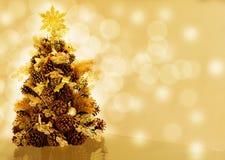 Christmas tree on bokeh background. Christmas tree made of pine cones on golden bokeh background Stock Images