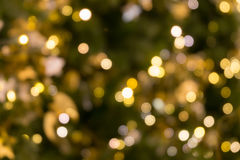 Christmas tree bokeh light in green yellow golden color, holiday abstract background, blur defocused stock images