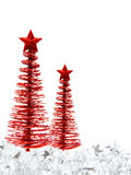 Christmas tree border. Vertical Christmas border of red trees and silver garland on a white background Royalty Free Stock Photography