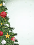 Christmas Tree Border Design. Christmas tree with red silver and gold ornaments. Copy space on right with faint snowflake designs Royalty Free Stock Photos