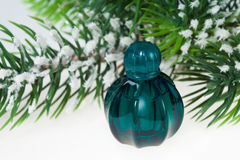 Christmas tree and bottle of perfume Stock Photography