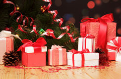 Christmas tree and boxes with gifts on abstract dark. Stock Image