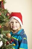 Christmas tree and boy Stock Image