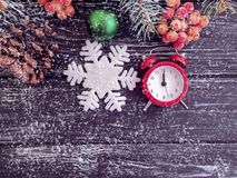 Christmas tree branch alarm decoration clock december on wooden snow background. Christmas tree branch alarm clock wooden snow background december decoration royalty free stock photography