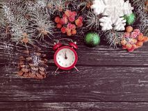 Christmas tree branch alarm decoration festive clock december on wooden snow background. Christmas tree branch alarm clock wooden snow background december stock images