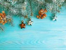 Christmas tree branch, ball snow on season winter decorative table celebration wooden background. Christmas tree branch ball on wooden background decorative stock image