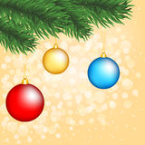 Christmas tree branch with baubles Royalty Free Stock Images