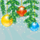 Christmas tree branch with baubles Stock Image