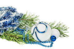 Christmas tree branch and blue ball with white glitter isolated Royalty Free Stock Photos
