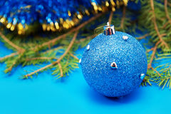 Christmas tree branch with blue bauble Royalty Free Stock Photography