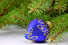 Christmas tree branch and blue heart. Stock Photography
