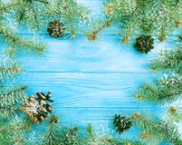 Christmas tree branch on a blue wooden decoration snow background frame. Christmas tree branch a blue wooden background frame snow decoration royalty free stock photos