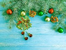 Christmas tree branch on a blue wooden decorative background, snow, frame, pine cone. Christmas tree branch on a blue wooden background, snow, frame, pine cone royalty free stock photos