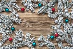 Christmas tree branch with Christmas balls Royalty Free Stock Photography