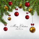 Christmas tree branch with colored balls Royalty Free Stock Photo