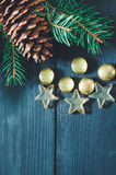 Christmas tree branch with cone and marbles Stock Photos