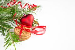 Christmas tree branch, cookies and red decoration Stock Image