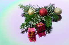 Christmas tree branch decorated with gold balls. Are reflected in the color mirror Royalty Free Stock Photo
