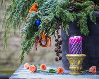 Christmas tree branch with decoration of Harlequin and parrot Stock Photo