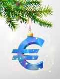 Christmas tree branch with decorative euro symbol Stock Image