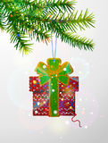 Christmas tree branch with decorative knitted gift Royalty Free Stock Photos