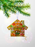 Christmas tree branch with decorative knitted house Royalty Free Stock Photos