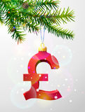 Christmas tree branch with decorative pound sterling symbol Royalty Free Stock Image