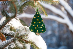 Christmas tree branch in the forest with green handmade decoration. Royalty Free Stock Photo