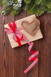 Christmas tree branch with gift box and heart toy Royalty Free Stock Images