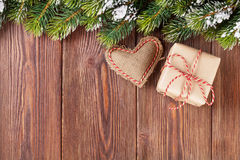 Christmas tree branch with gift box and heart toy Royalty Free Stock Photo