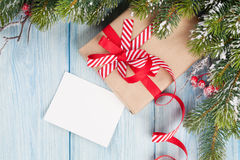 Christmas tree branch, with gift and greeting card Stock Images