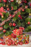 Christmas tree branch with a gift Stock Image