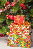 Christmas tree branch with a gift Stock Photography