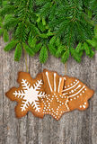Christmas tree branch with gingerbread cookies decoration Stock Photography