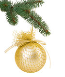 Christmas tree branch with a gold Christmas ball with ribbon Stock Photography