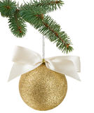 Christmas tree branch with a gold Christmas ball with ribbon Royalty Free Stock Photo