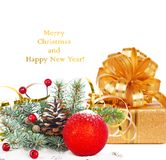 Christmas tree branch with gold serpentine, gift box Stock Photography