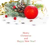 Christmas tree branch with gold serpentine and red sphere Stock Images