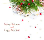 Christmas tree branch with gold serpentine and red sphere Royalty Free Stock Photo