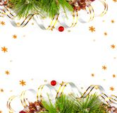 Christmas tree branch with gold serpentine and red sphere Stock Photo