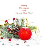 Christmas tree branch with gold serpentine and red sphere Stock Photography