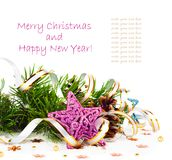 Christmas tree branch with gold serpentine and star Stock Image