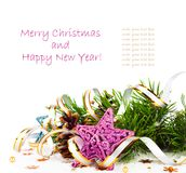 Christmas tree branch with gold serpentine and star Stock Photography