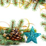 Christmas tree branch with gold serpentine and star Stock Photos