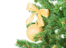 Christmas tree branch with golden decorations beckground Royalty Free Stock Photography