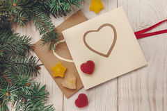 Christmas tree branch,jujube and cards with hearts Stock Photography